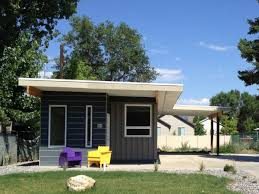 small modern custom contrainer house for sale that has black wall