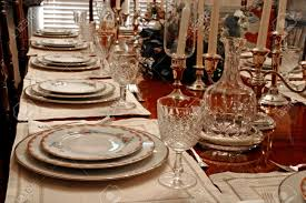 a formal dining table set with china crystal and candles stock
