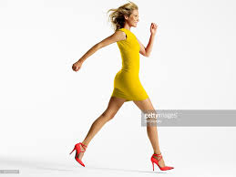 colorful dress woman in colorful dress jumping in studio stock photo getty images