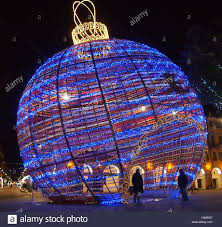giant christmas tree ball decoration illuminated in the city at