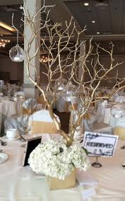 manzanita branches centerpieces reception centerpieces arrangement includes gold sprayed
