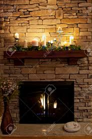 a sleeping kitty by a cozy fireplace the mantle is decorated