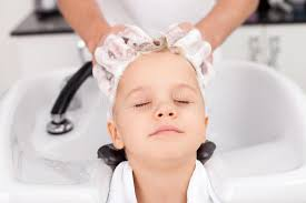 pretty verry young boys washing hairs skilled young hairdresser is treating hair of stock image image