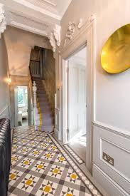 grey and yellow entryway hallway love the beautiful modern take