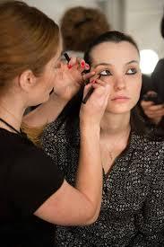 global celebrity makeup artist lauren andersen backse at the nicholas k spring 2016 runway show at new york fashion week using avon mega effects liquid