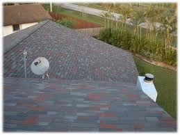 multi color shingle roof blends best with light gray or blue