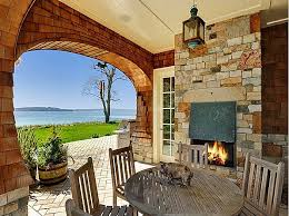 back porch with fireplace hooked on houses