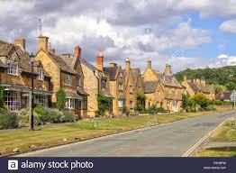 street with pretty vintage cottage houses in broadway england