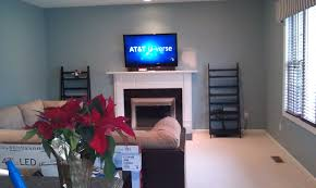 decoration awesome mounting a tv over a fireplace with stone