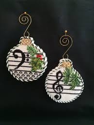 loved finishing these musical note ornaments needlepoint