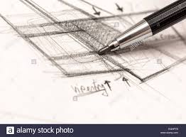 architect hand drawing house plan sketch with pencil stock photo