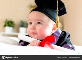 toddler cap and gown baby girl in graduation cap and gown stock photo melpomene