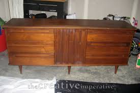 furniture mid century dresser with storage before white wall on