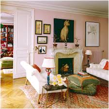living room with pink color with decorations have paintings of