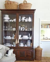 how to arrange a china cabinet pictures the tricks you need to know for decorating above cabinets laurel home
