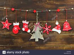 rustic shabby chic christmas decorations hanging on brown wooden