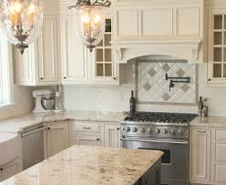 stone countertops cream colored kitchen cabinets lighting flooring
