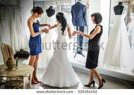 female trying on wedding dress shop stock photo 335454452