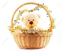 fluffy white teddy in a basket witn gold garland stock photo