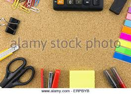wallpaper stationary on cork board with many office supplies tools