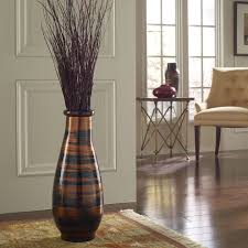 Vases Decor For Home A Large Floor Vases Decorate A Living Room Beside A White Sofa