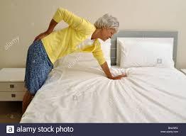 back pain pensioner senior old woman mature lumbago hurt pain