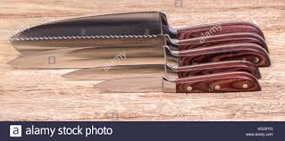 knives sharpen stock photos knives sharpen stock images alamy set of high quality kitchen knives on a cutting board stock image