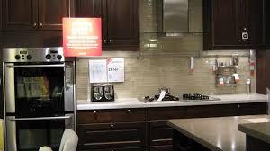under upper cabinet lighting kitchen dark cabinets light glass front upper cabinet single white