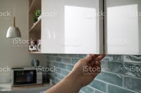 open kitchen cabinets with no doors kitchen cabinet with doors without handles the mans shows how the doors open without handles stock photo image now