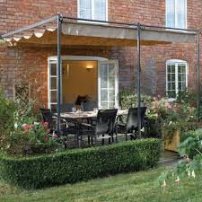 diy patio awning ideas with dining table and and unique fence and