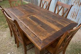 barn door dining table barnwood beam leg barn door table