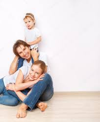 happy family on floor near empty wall in the apartment bought on