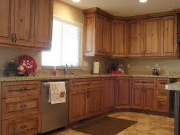 brown cherry wooden kitchen cabinet and marble countertop on