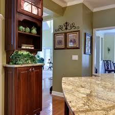 golden oak wood floor with sage green walls i also like the crown