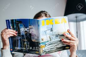 Ikea Catalogue 2014 by Paris France August 24 2014 Woman Reading Ikea Catalogue