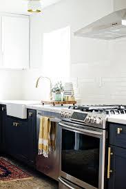 navy blue kitchen cabinets with brass hardware big comeback brass kitchen hardware centsational style
