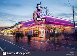the wildwood boardwalk and stores at twilight with neon