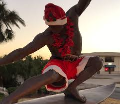 kelly slater statue in cocoa beach in christmas gear the inertia
