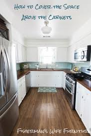 Ideas For Decorating The Top Of Kitchen Cabinets by Fisherman U0027s Wife Furniture Covering Fur Down The Space Above