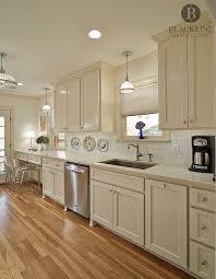 what color quartz with cabinets traditional kitchen design by blackline renovations quartz