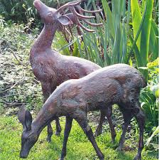 garden animal doe sculpturesowls statuesgarden candle and blue