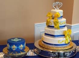 wedding cake royal blue royal blue yellow and white wedding cake with grooms cake