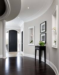 painting stained wood trim its grey ok dark wooden floor wall finishes and entrance halls