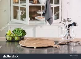 Cutting Board Kitchen Countertop - empty cutting board behind kitchen cupboard stock photo 374907514