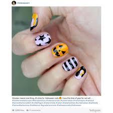 Halloween Nail Art Pumpkin - 12 halloween nail art ideas southern living