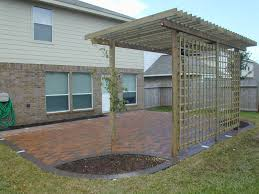 Small Patio Pavers Ideas Brown Ceramics Patio With Brown Wooden Pergola And Green Grass