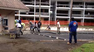 bojay inc pouring concrete pool deck at the waiakea villas hilo hawaii
