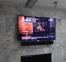 decoration mesmerizing mounting a tv over a fireplace and granite