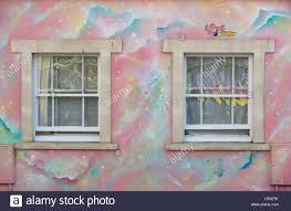 Painted Wall Mural Two Windows Surrounded By A Rainbow Painted Wall Mural With