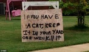 mississippi s yard sign promises to kill stray cats on his